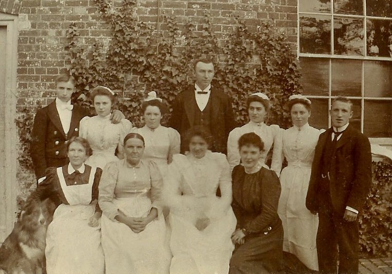 Mary J Cobbett in service, standing 3rd from right.
